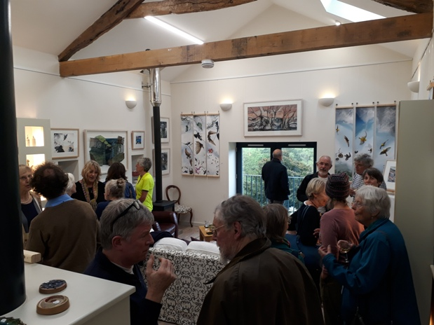 photo of people at exhibition preview